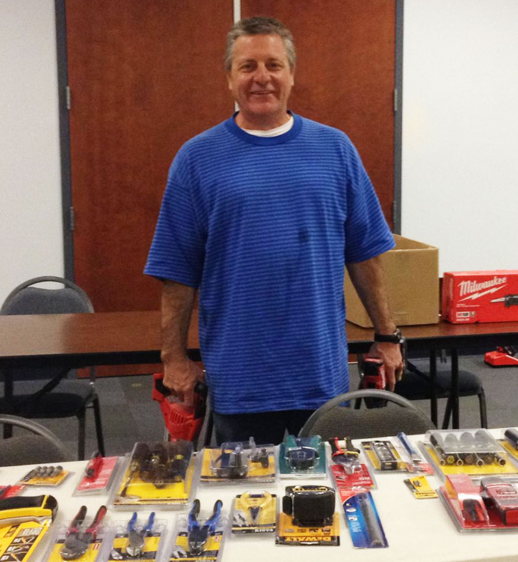 Bruce with some of his tools, a successful FIT client.